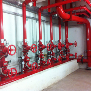 An installation of fire safety water pipes and valves